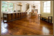 The natural warm pumpkin tones are a trademark of Antique Heart Pine flooring.